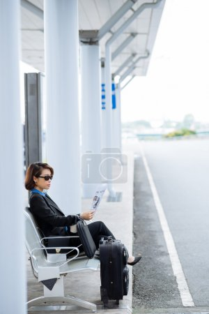 Business lady with a suitcase