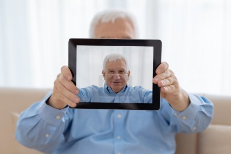 Photo for Senior man taking selfie with digital tablet - Royalty Free Image