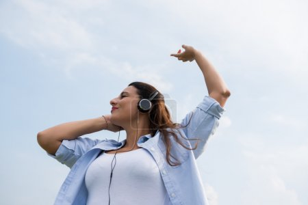 Woman enjoying song
