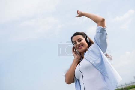 woman listening to the music and dancing