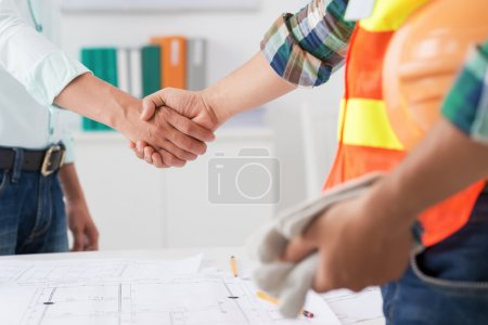 engineer and investor shaking hands