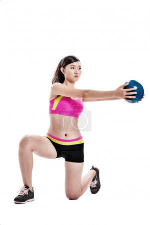 Girl doing squats with a ball