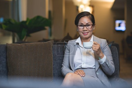 businesswoman in cafe with cup of coffee