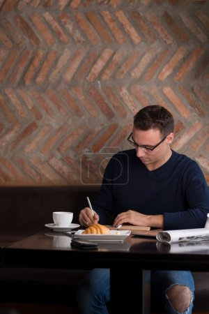 Male journalist working on article