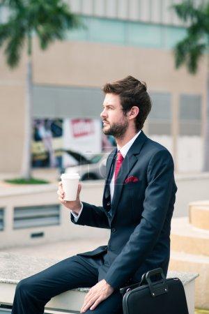 Businessman enjoying his morning coffee