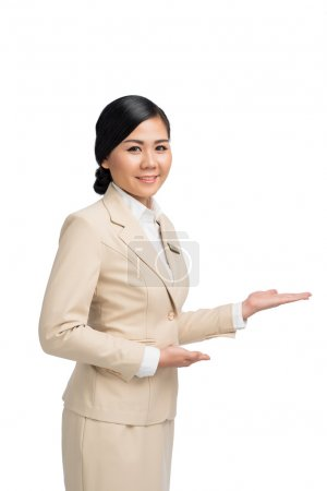 Photo for Asian business lady showing something in her hands - Royalty Free Image
