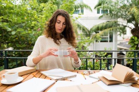 Copywriter taking photo of her notes