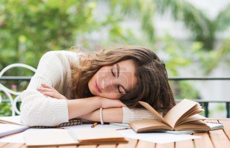 woman fell asleep when doing homework