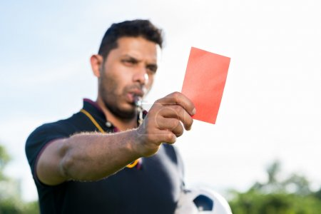 Soccer referee showing penalty card