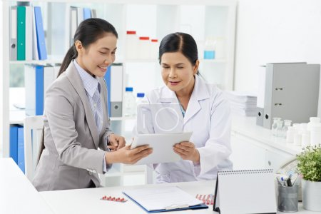Vietnamese business lady and medical worker