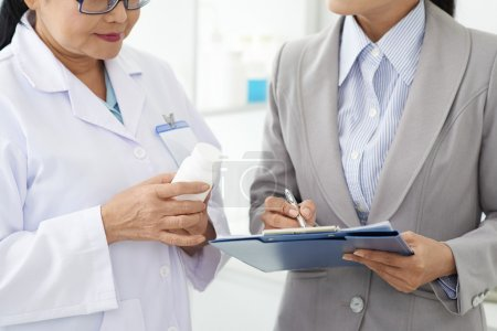 Scientist and business woman filling information