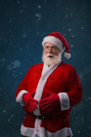 Santa Claus touching his belly