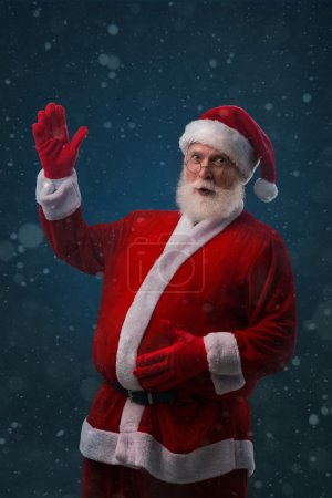 Photo for Santa touching his belly and waving at you - Royalty Free Image