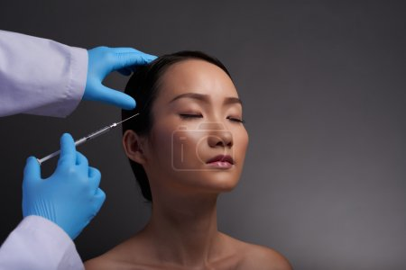 Woman getting course of injection
