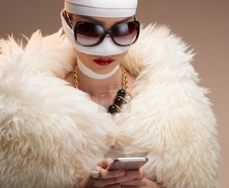Woman text messaging after rhinoplasty