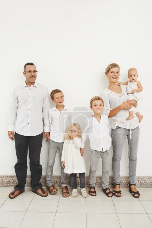 Photo for French happy family of six standing at the wall - Royalty Free Image