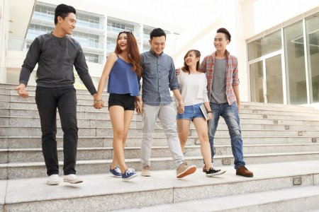 Photo for Group of teenagers walking together from school - Royalty Free Image
