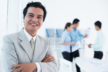 Cheerful experienced businessman