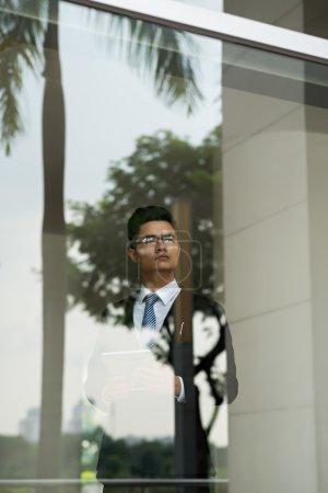 Pensive Businessman at window