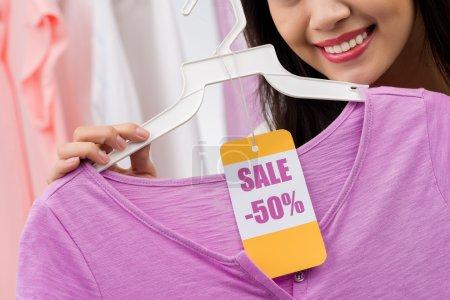 woman buying a shirt