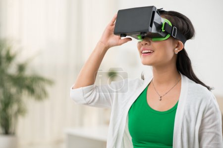 Photo for Woman in virtual reality glasses playing the game - Royalty Free Image
