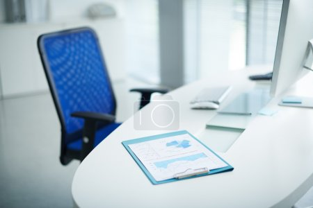 Photo for Table of business person with financial report on it - Royalty Free Image