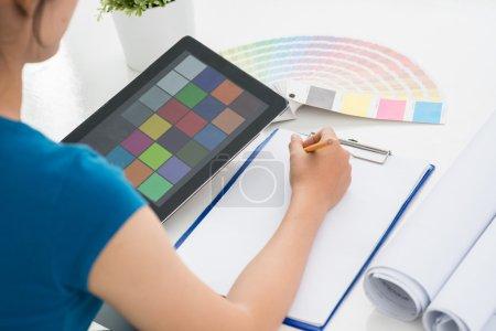 Designer choosing perfect color