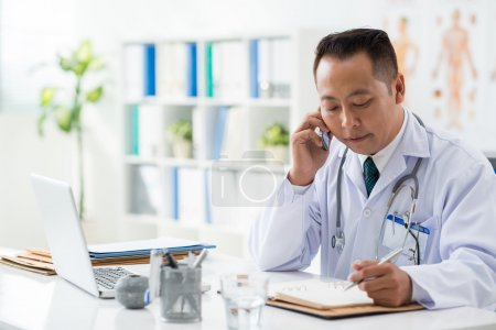 Doctor checking his daily planner