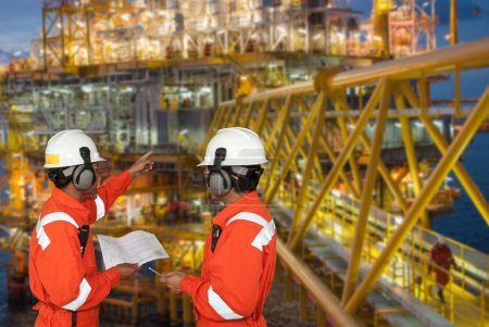 Ölarbeiter und Bohrinsel. Montagekonzept