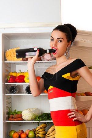 woman opens a bottle of wine