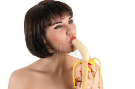 beautiful sexy woman eating banana