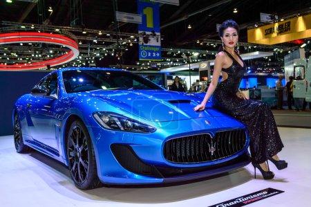 Female presenters model with Maserati