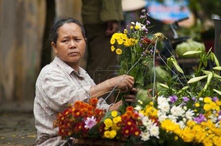 Unidentified florist vendor in the small market at April 21,2014 in hanoi, vietnam.