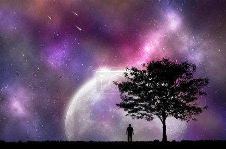 Silhouette man and tree with night sky.