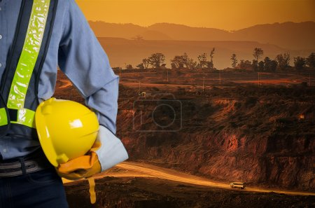 Engineer holding yellow helmet