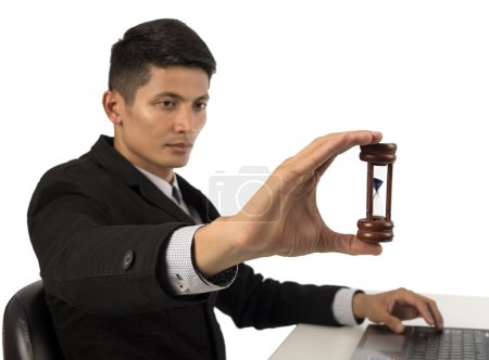 hand holding hourglass.