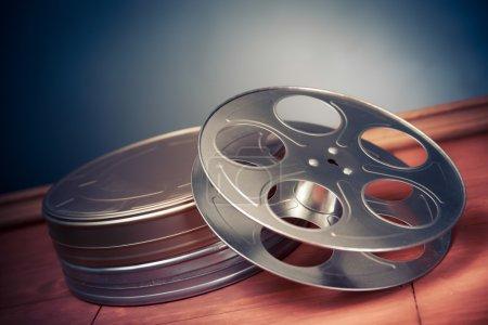 filmmaking scene with dramatic lighting, movie reel