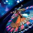 Roulette wheel with a bright and colorful backgrou...