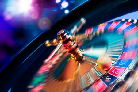 Roulette wheel in motion with a bright and colorfu...