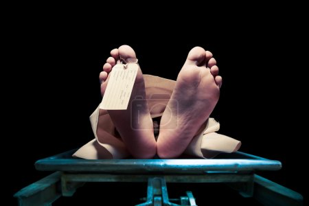 Feet on a morgue table