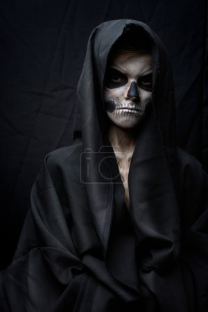 Teenager with makeup skull cape