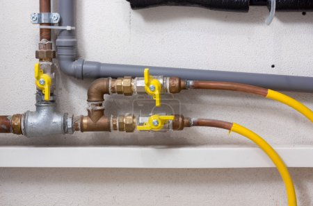 Pipes and Faucets in a Boiler Room