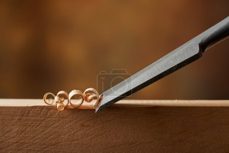 Woodworking tool. Carving wood with chisel