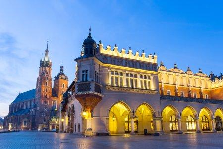 Sukiennice and St. Mary's Church at night in Krakow, Poland.