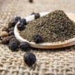 Black pepper on the wooden spoon...
