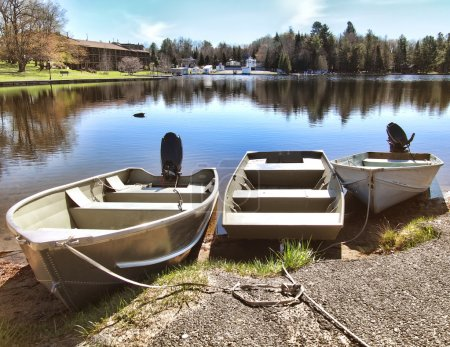 Boats docked on the Fulton Chain Lakes in Old Forg...
