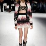 MILAN, ITALY - SEPTEMBER 23: model walks the runwa...