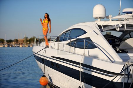 Woman on the deck of motorboat