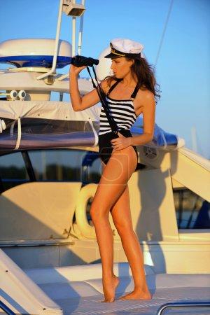Woman on the deck holding binoculars