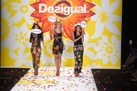 Models walk the runway finale at Desigual during Mercedes-Benz Fashion Week Spring 2015